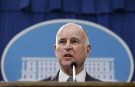 """FILE - In this Jan. 10, 2017, file photo, California Gov. Jerry Brown discusses his 2017-2018 state budget plan he released at a news conference in Sacramento, Calif. Gov. Jerry Brown likened President Donald Trump to a strongman whose goal of walling off the U.S.-Mexico border conjures other infamous barriers from the past. Brown said during an interview broadcast Sunday, March 26, 2017, on NBC's """"Meet the Press"""" that the president's promised border wall is """"ominous"""" and reminiscent of the Berlin Wall. (AP Photo/Rich Pedroncelli, File)"""