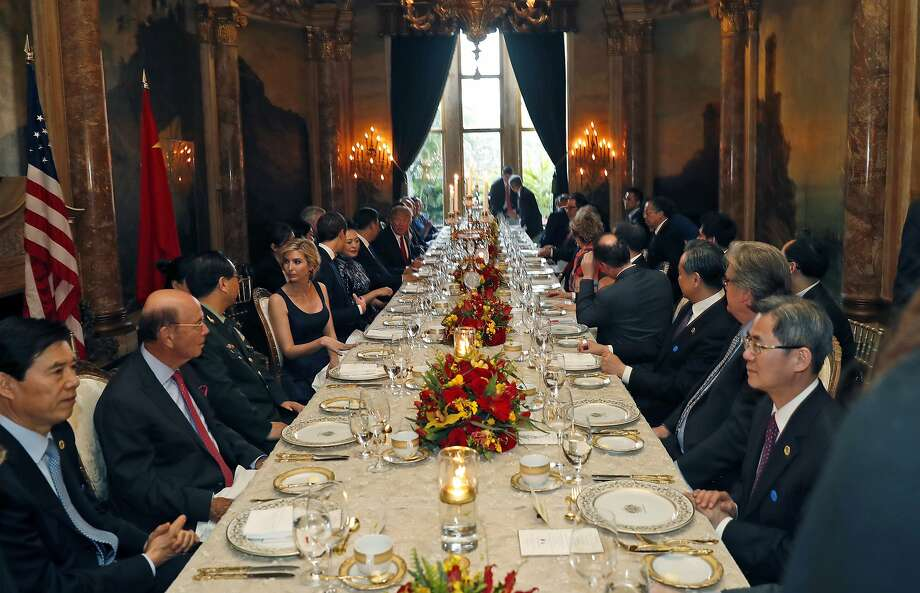 President Donald Trump and Chinese President Xi Jinping, with their wives, first lady Melania Trump and Chinese first lady Peng Liyuan are seated at the center, during a dinner at Mar-a-Lago, Thursday, April 6, 2017, in Palm Beach, Fla. Photo: Alex Brandon, Associated Press