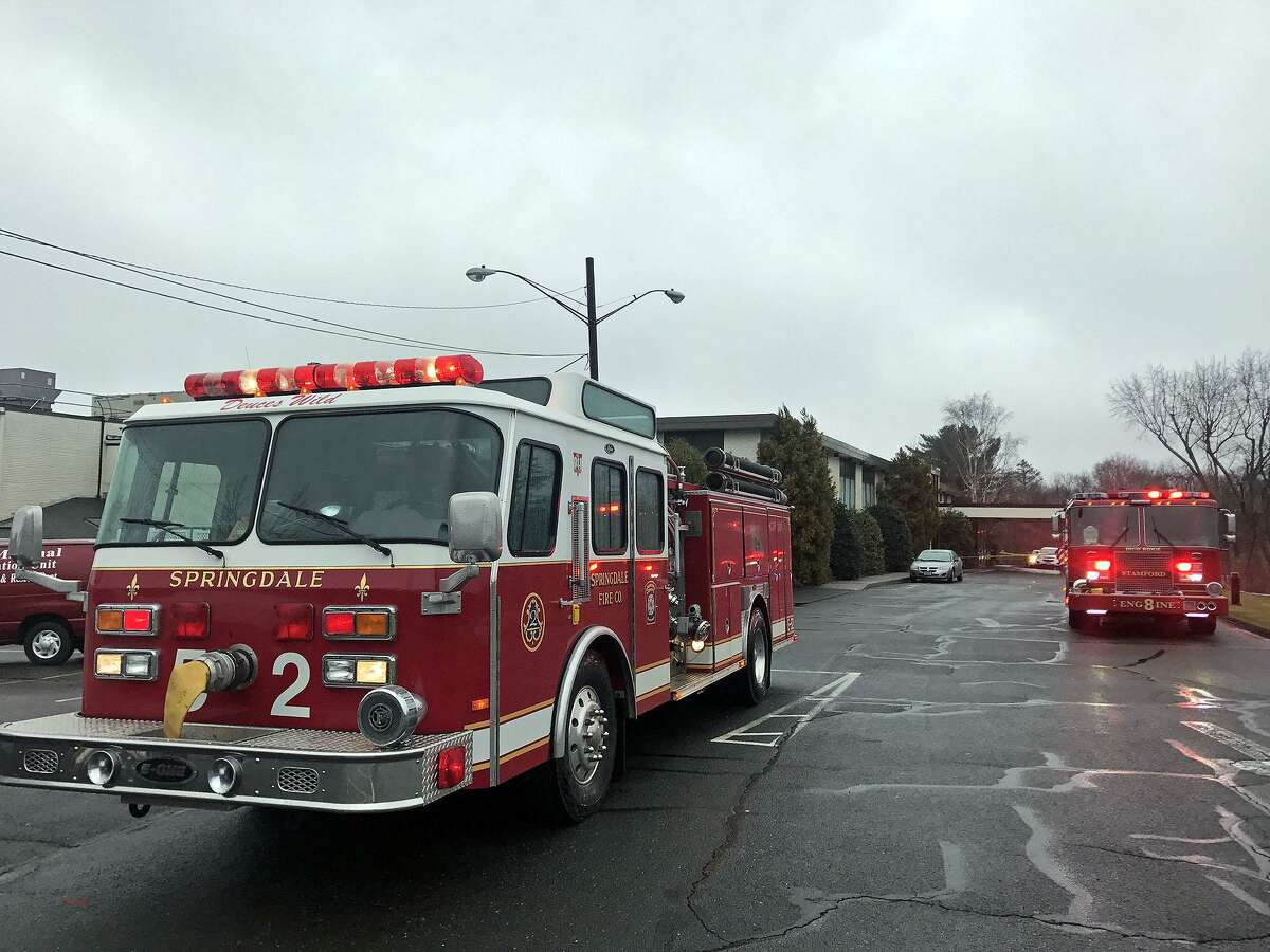 Stamford firefighters respond to a two-alarm blaze that they say started in the woman's locker room of the Italian Center on Newfield Avenue, Stamford, Conn, April 6, 2017.