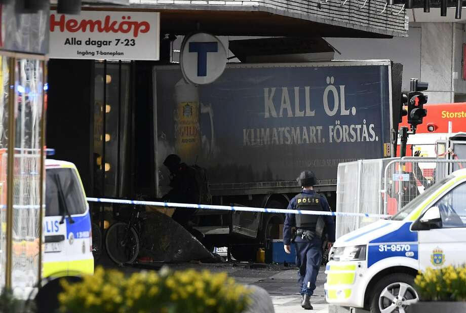 "Police cordon off the truck that crashed into the a department store in central Stockholm. ""Sweden has been attacked,"" Prime Minister Stefan Lofven said on national TV. Photo: JONATHAN NACKSTRAND, AFP/Getty Images"