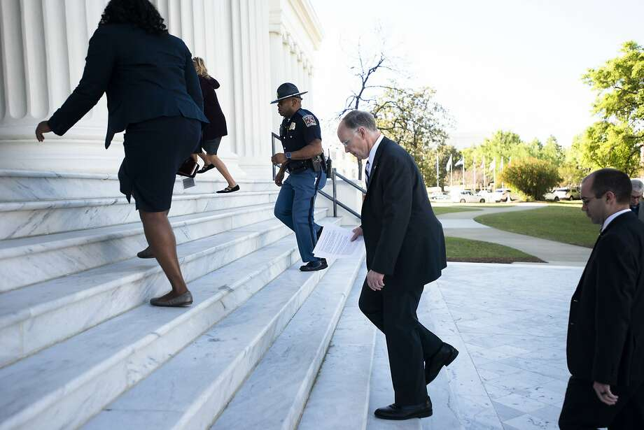 Alabama Gov. Robert Bentley leaves a news conference outside the state Capi tol in Montgomery. Calls for his resignation have grown amid a sex scandal. Photo: Albert Cesare, Associated Press