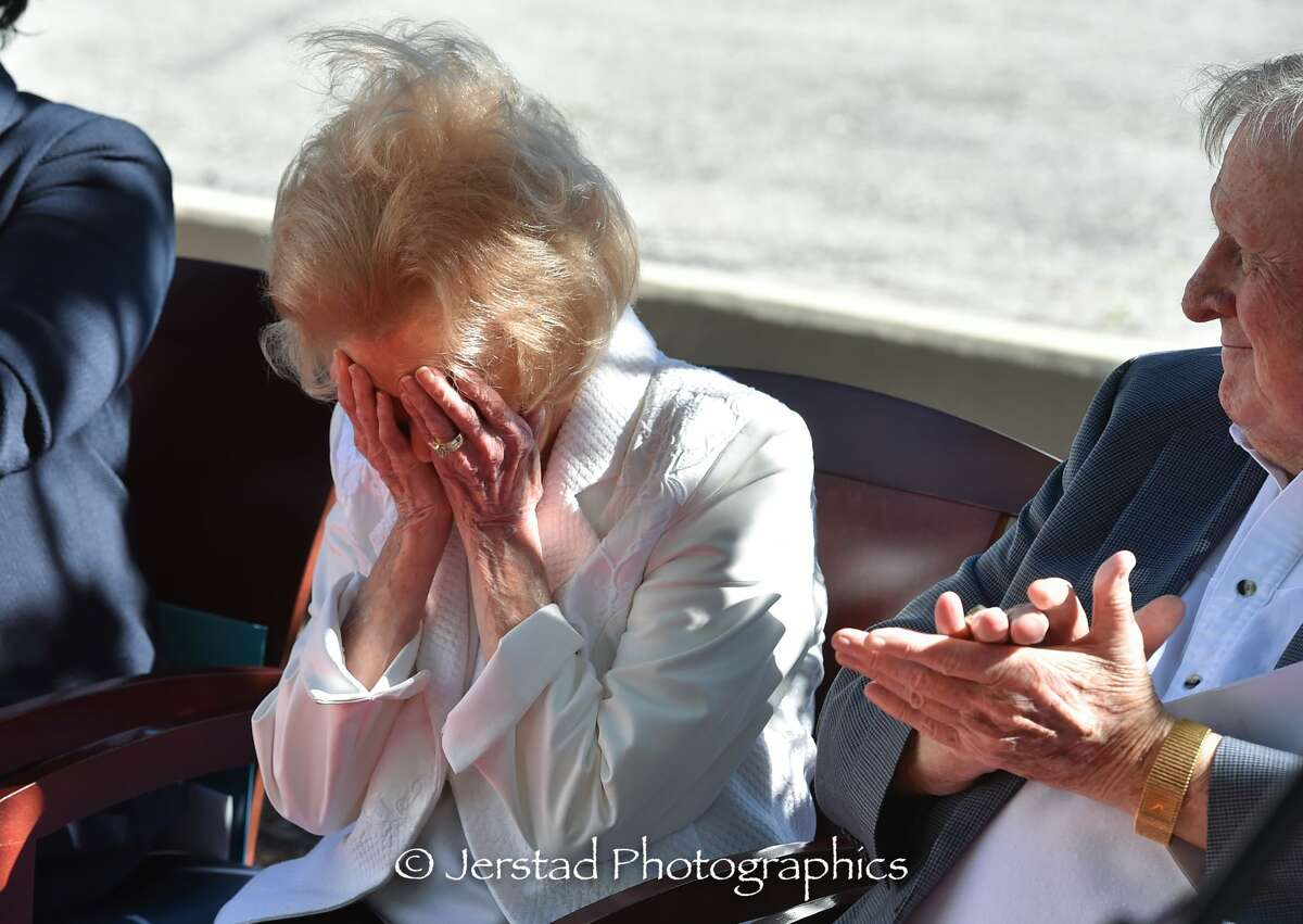 Charline McCombs reacts to the unveiling of KLRN's media center with shock and tears.
