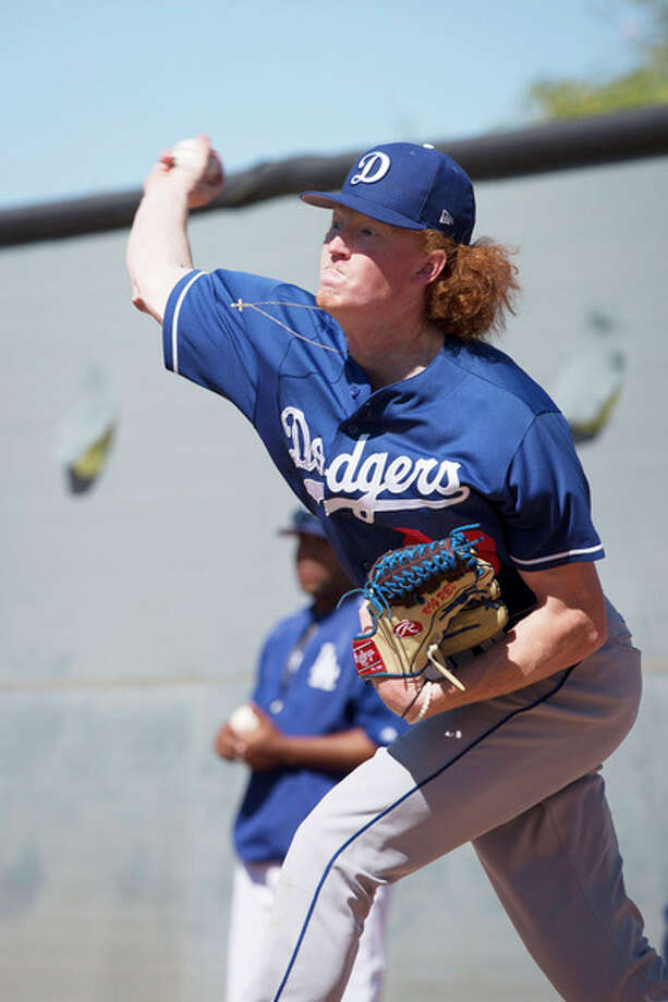 CAITLIN O'HARA | For the Daily News Great Lakes Loons' pitcher Dustin May is nicknamed 'Big Red' for his red hair and 6-foot-6 stature. The Los Angeles Dodgers drafted him in the third round last June. / Caitlin O'Hara