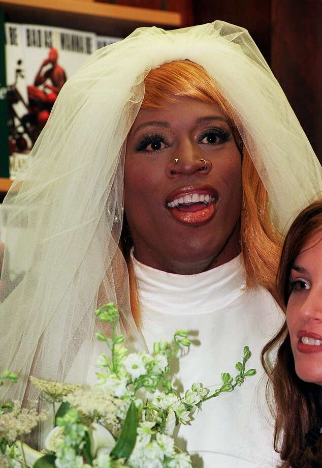 """Chicago Bulls basketball forward Dennis Rodman, dressed as a bride, poses for photographers at a Manhattan bookstore Wednesday, Aug. 21, 1996.  Rodman was promoting his book, """"Bad As I Wanna Be."""" (AP Photo/Mark Lennihan) Photo: MARK LENNIHAN, Associated Press"""