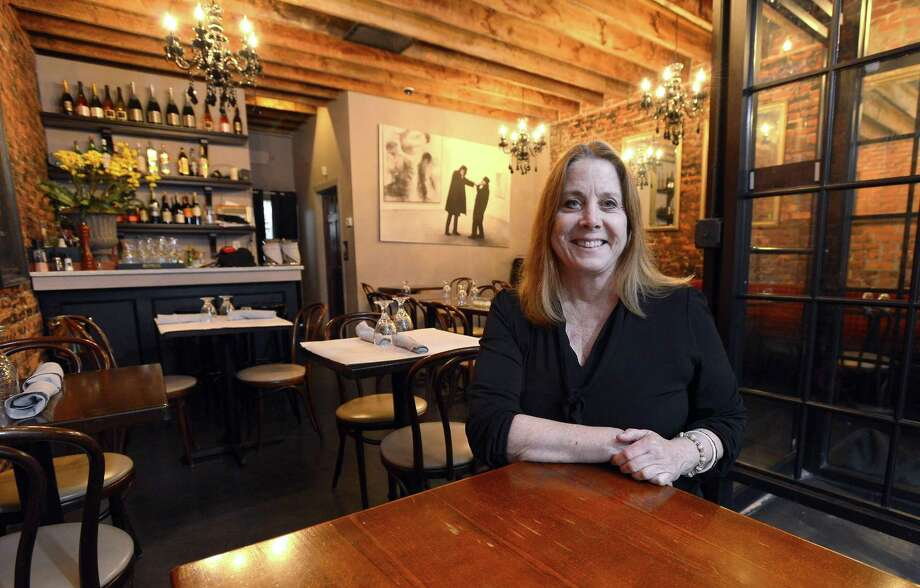 Carrin Schechter, owner of Noir is photograph inside the dining room of her Stamford restaurant on April 6, 2017. Photo: Matthew Brown / Hearst Connecticut Media / Stamford Advocate