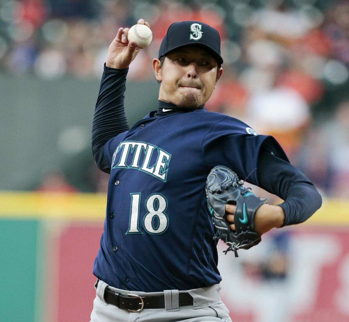 HOUSTON, TX - APRIL 04: Hisashi Iwakuma #18 of the Seattle Mariners pitches in the first inning against the Houston Astros at Minute Maid Park on April 4, 2017 in Houston, Texas. (Photo by Bob Levey/Getty Images)