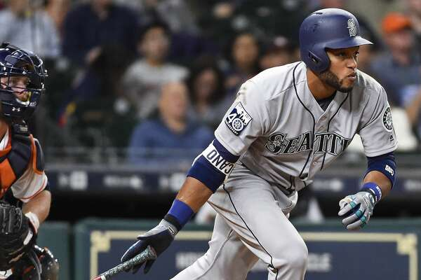 Seattle Mariners' Robinson Cano runs to first after hitting a single during the sixth inning of a baseball game against the Houston Astros, Thursday, April 6, 2017, in Houston. (AP Photo/Eric Christian Smith)