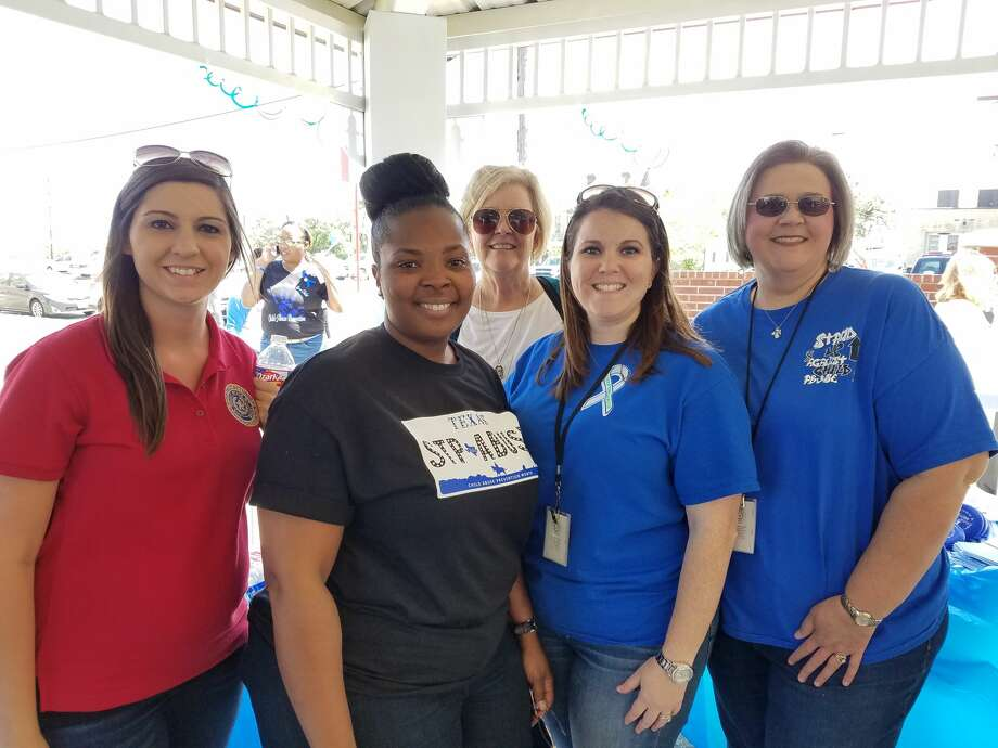 """Coinciding with Child Abuse Awareness Month, the Texas Department of Family and Protective Services hosted """"Go Blue Day"""" in Beaumont April 7, 2017. The event included a program, a walk, and ended at the Beaumont Police Station where 222 teddy bears lined the steps representing fatal child abuse victims in Texas last year. Three of the 222 represent Jefferson County children. Photo: Monique Batson/The Enterprise"""