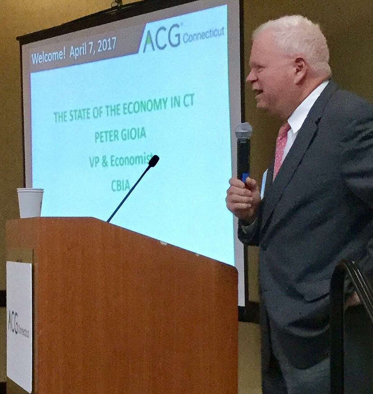 Connecticut Business & Industry Association economist Peter Gioia gives a speech to the Connecticut chapter of the Association for Corporate Growth, on Friday, April 7, 2016, at the Stamford Sheraton hotel.