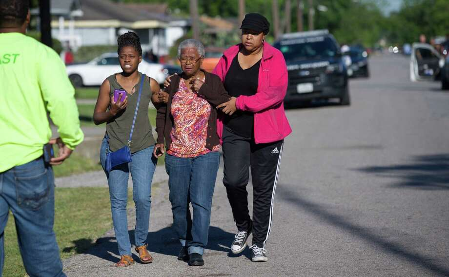 Family members exit the crime scene where Houston Police officers investigated a murder suicide that left three people dead on the 3800 block of Mount Pleasant Street Friday, April 7, 2017, in Houston. Photo: Godofredo A. Vasquez, Houston Chronicle, Godofredo A. Vasquez / Houston Chronicle