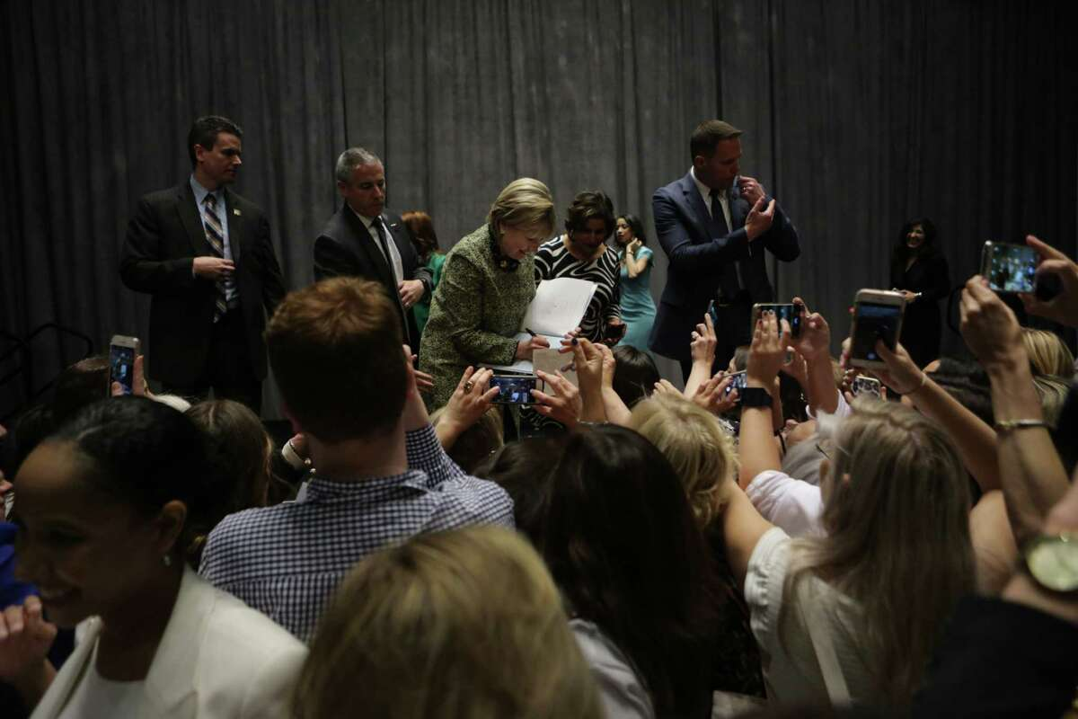 Secretary Hillary Rodham Clinton sigs an autograph after her speech at Annie's List annual Houston luncheon, Friday, April 7, 2017, in Houston.