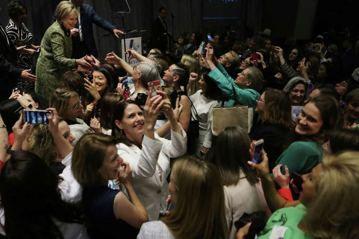 Audience at the Annie's List annual Houston luncheon greet and take selfies as Secretary Hillary Rodham Clinton tries to greet them from the stage after her speech, Friday, April 7, 2017, in Houston.