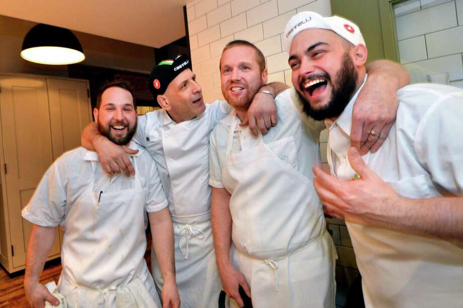 Chef de cuisine Matt Arcomone, Executive Chef Marc Vetri, Culinary Director Brad Spence and Chef de cuisine Drew DiTomo enjoy a few laughs during a soft opening of the new Amis restaurant in Bedford Square on   March 30  in Westport. Photo: Alex Von Kleydorff / Hearst Connecticut Media / Norwalk Hour