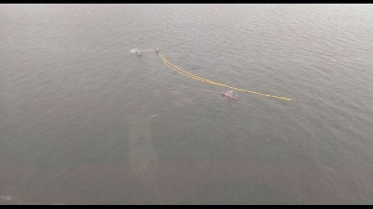 KTVU captured these images of the fuel spill containment effort following a barge going under on the San Francisco Bay.