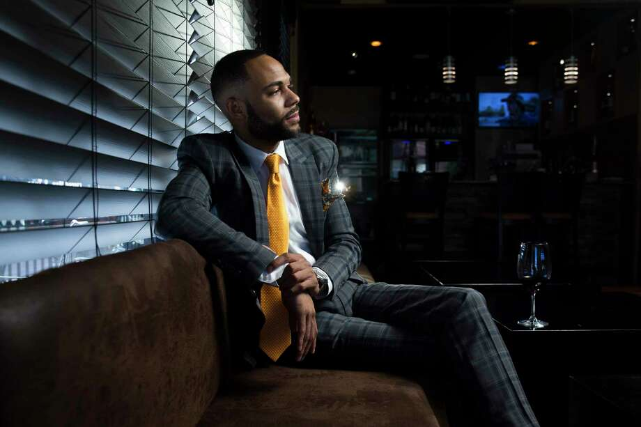 Warren Luckett, founder of Black Restaurant Week and co-owner of Branwar Wines, at UnWine on Almeda. His suit by JPR Styling, a pocket square by Nigerian brother iGrushi and tie and socks from McQueens. Photo: Michael Ciaglo, Staff / Michael Ciaglo