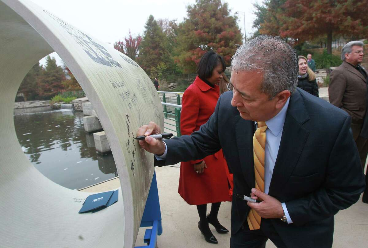 San Antonio Water System President and CEO Robert R. Puente signs a 54-inch diameter pipe to launch the Vista Ridge pipeline in 2014. Now that Vista Ridge water is flowing, a reader wonders why watering restrictions are in effect.