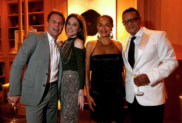 """Becca Thrash with Naeem Khan and his wife at """"Krug Journey,""""  a party hosted by Krug Champagne, Designer Naeem Khan and Becca Cason Thrash in Thrash's home on Tuesday, March 28, 2017, in Memorial. (Annie Mulligan / Freelance)"""