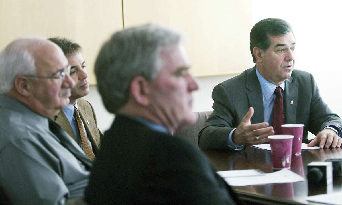 Former Stamford Mayor Michael Pavia meets with ex-department heads Michael Larobina, Director of Legal Affairs, Ernie Orgera, Director of Operations, Frederick Flynn, Director of Administration, and Laure Aubuchon, Director of Economic Deveolpment at the Government Center in 2010.