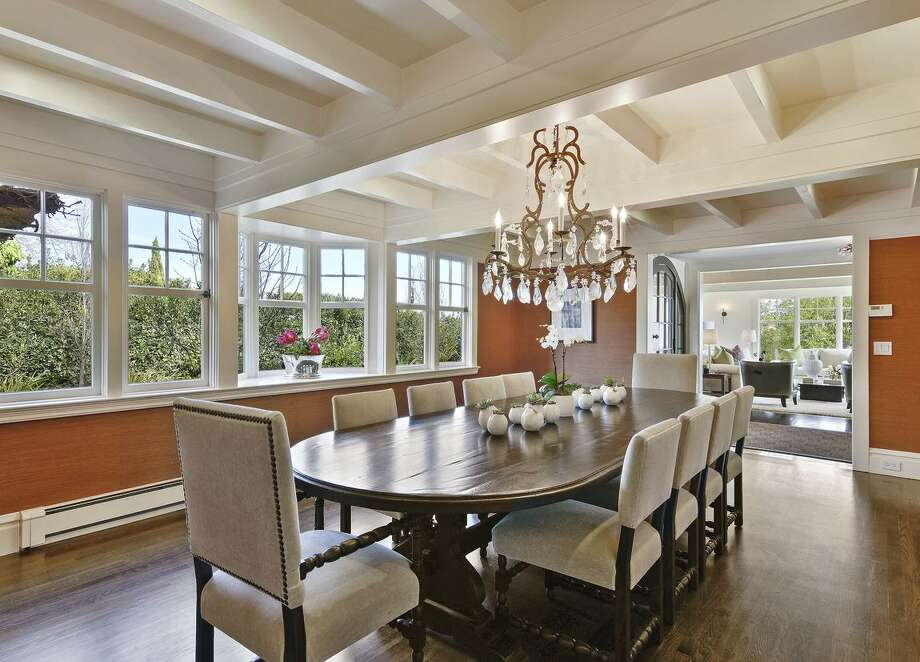 The formal dining room offers a beamed ceiling and a bay window. / ONLINE_CHECK