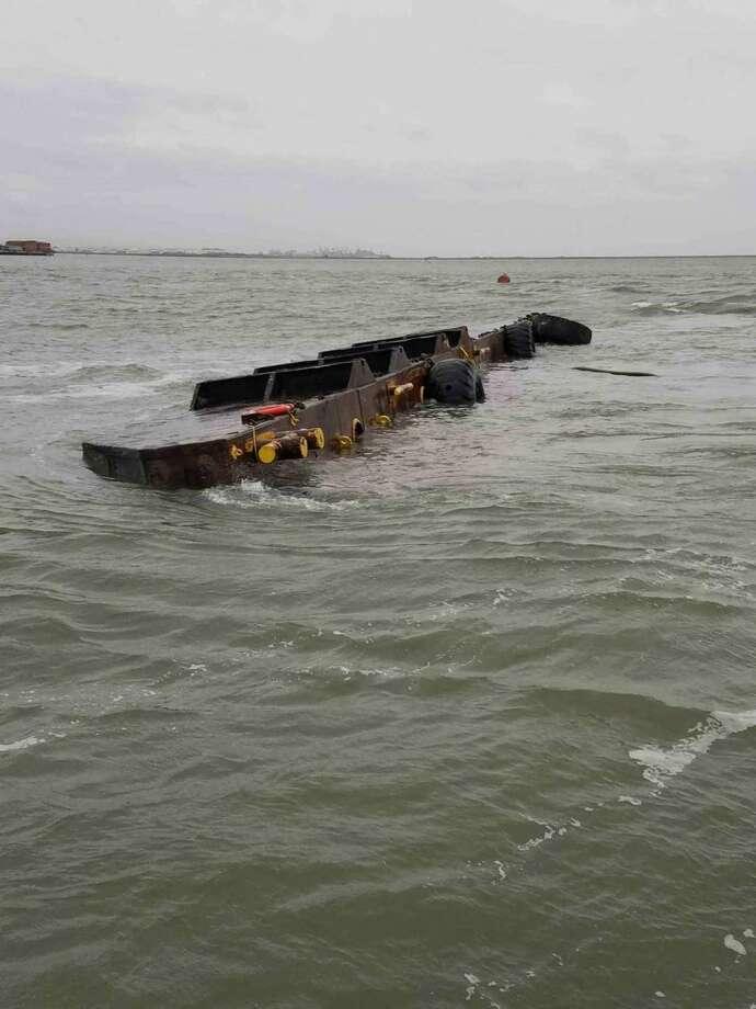 A 112-foot freight barge capsized off of Yerba Buena Island on Friday. Photo: Coast Guard / / Coast Guard