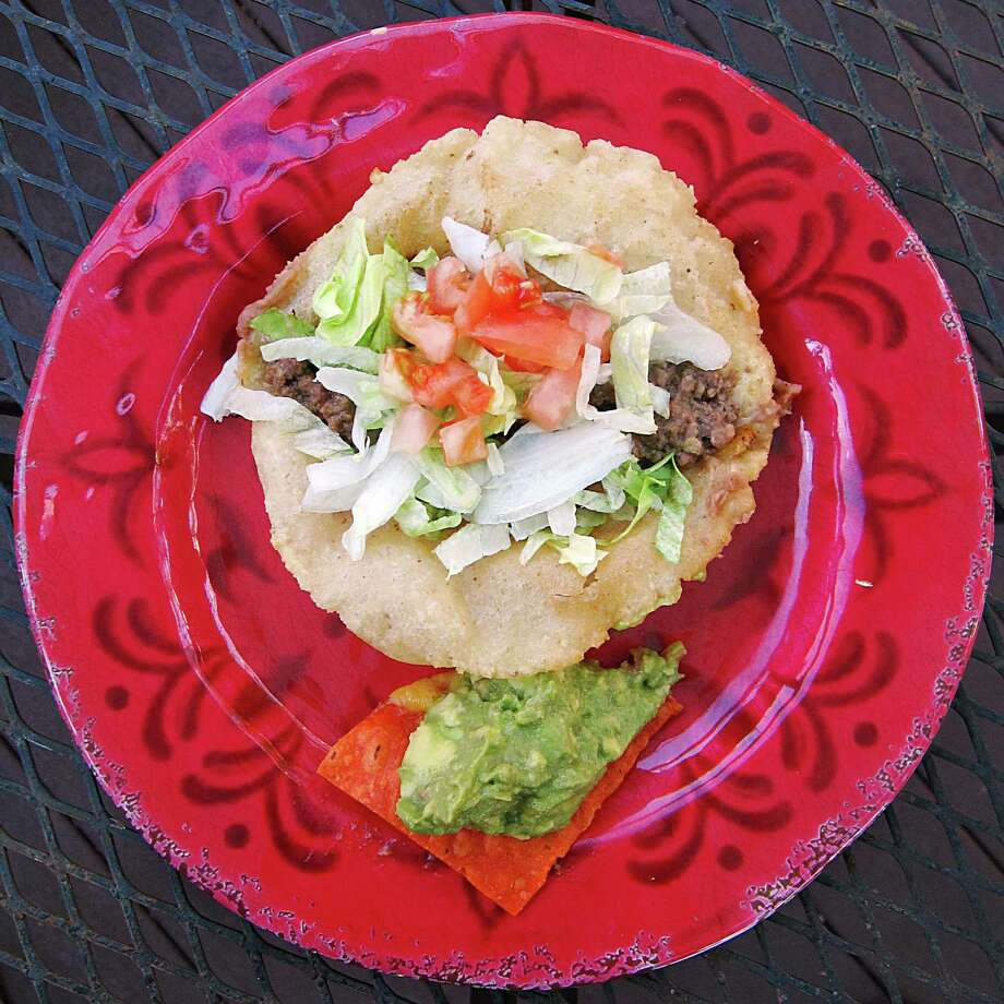 Beef puffy taco from Los Barrios Mexican Restaurant on Blanco Road. Photo: Mike Sutter /San Antonio Express-News
