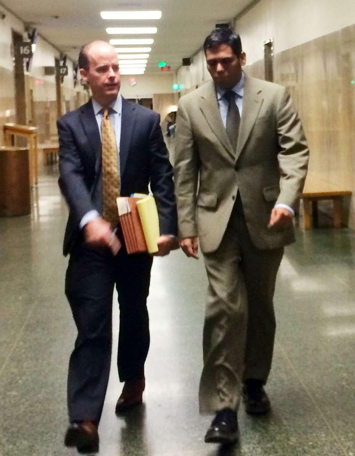 Enrique Pearce walks into court Friday alongside attorney, Sam O'Keefe.