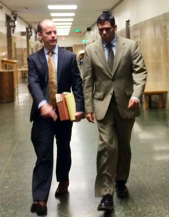 Enrique Pearce walks into court Friday alongside attorney, Sam O'Keefe. Photo: Sarah Ravani / The Chronicle / /