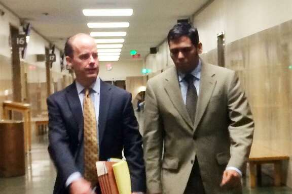 Enrique Pearce walks into court Friday alongside attorney, Sam O'Keefe.