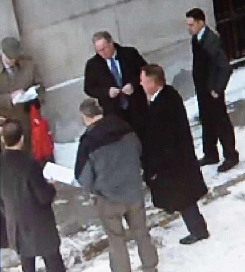 Officials with the office of Attorney General Eric Schneiderman confront Rensselaer County District Attorney Joel E. Abelove with a search warrant and seize his county-issued cell phone as he arrives for work on Thursday, March 16, 2017. Abelove's handling of an April 2016 fatal police shooting in Troy is the subject of an ongoing criminal investigation. The state probe is examining whether Abelove interfered with the attorney general's jurisdiction when he presented the case to a grand jury that cleared a Troy police sergeant less than a week after the officer killed a DWI suspect. (Video courtesy NYS Office of Court Administration)