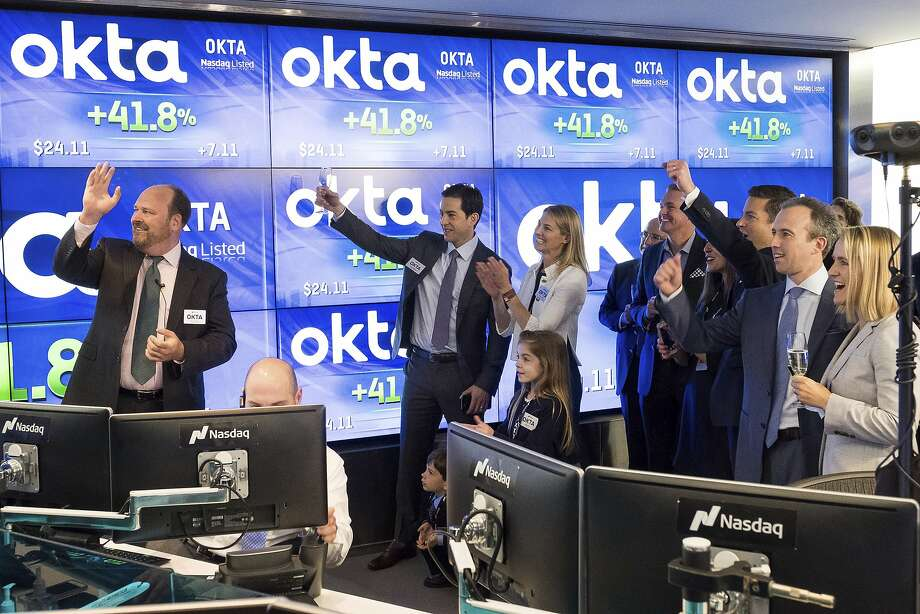 Okta CEO Todd McKinnon, center, and Chief Operating Officer Frederic Kerrest, second from right, celebrate the first trade at Okta's initial public offering, at the Nasdaq offices in New York on Friday. Photo: Charles Sykes, Associated Press