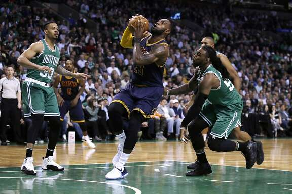 Cleveland Cavaliers forward LeBron James drives to the basket during the fourth quarter of an NBA basketball game in Boston, Wednesday, April 5, 2017. The Cavaliers defeated the Celtics 114-91. (AP Photo/Charles Krupa)