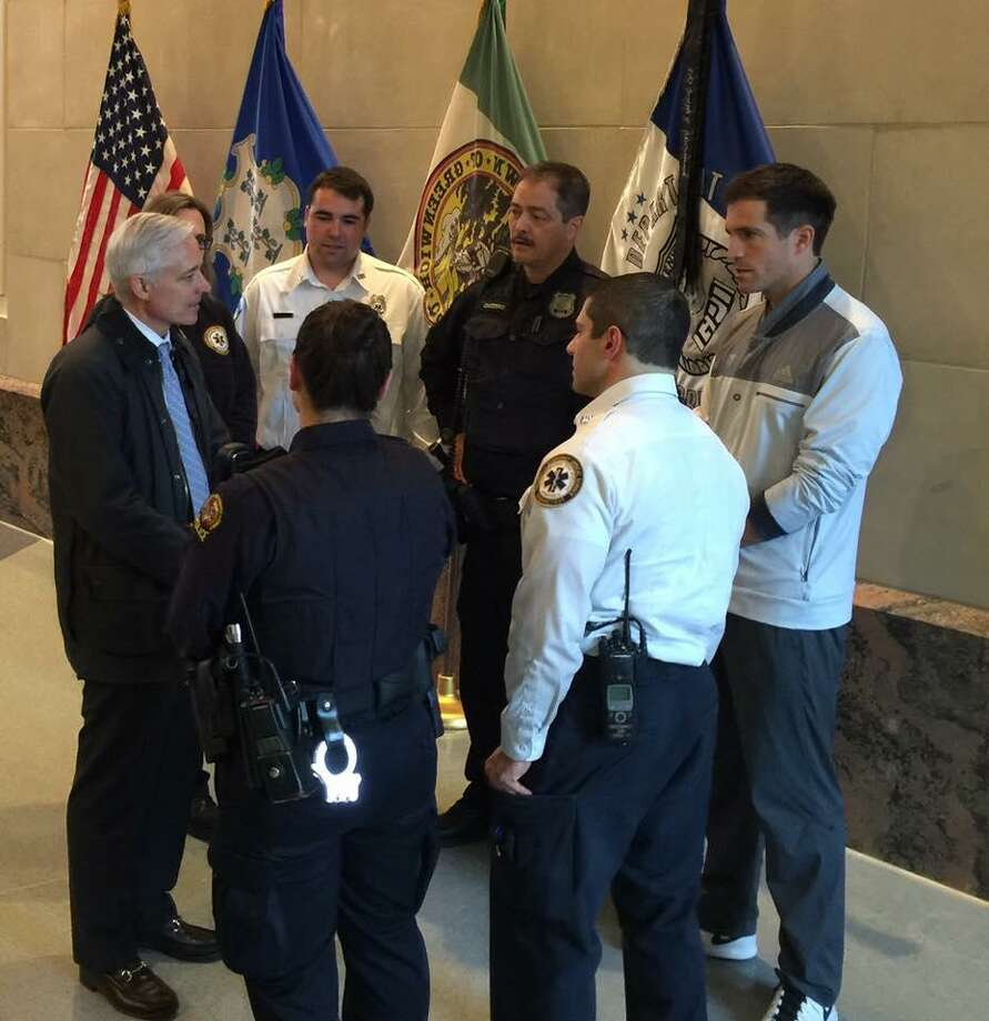 Roland Morris chats with police and emergency medical workers. Photo: / GPD