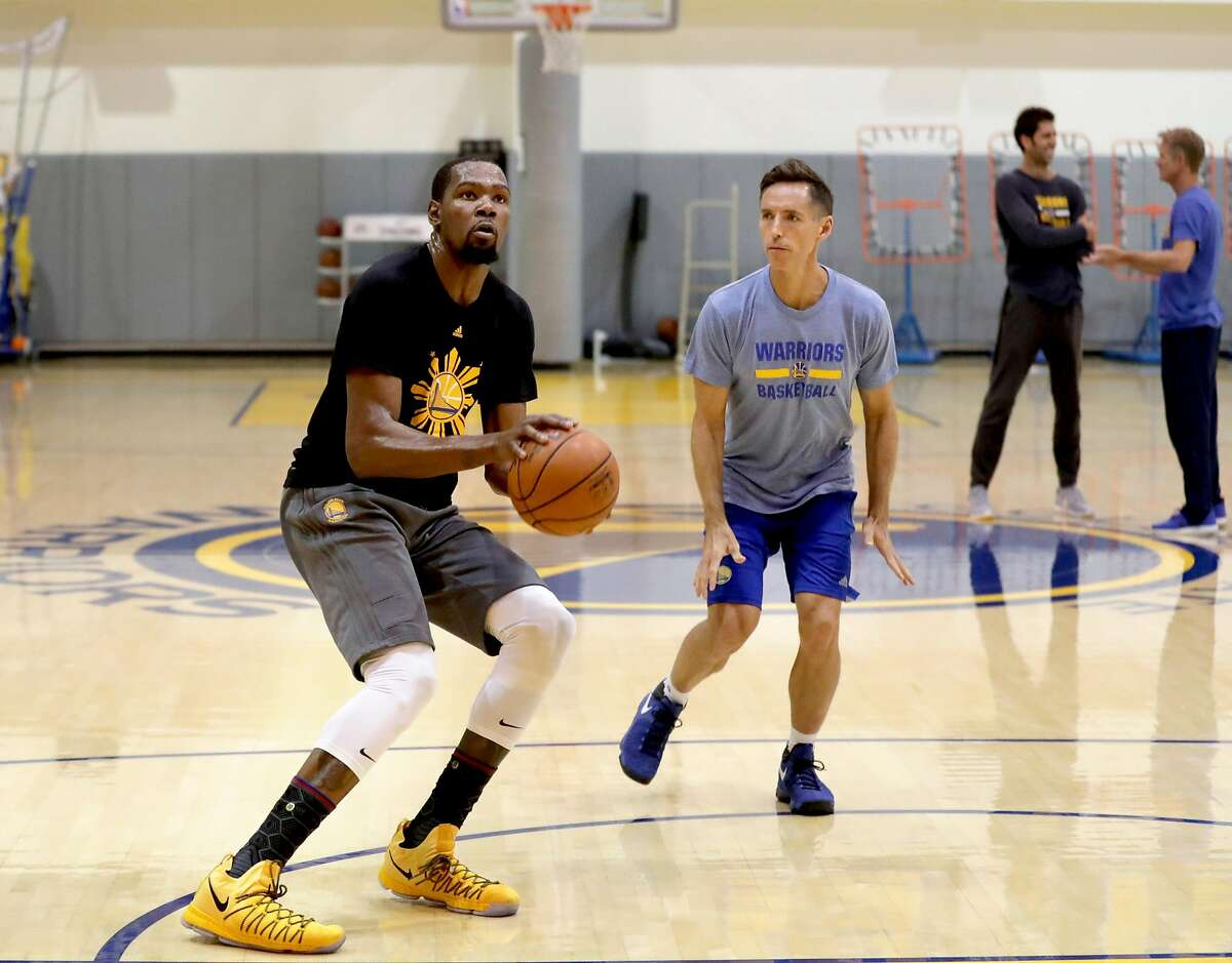 Kevin Durant works out with Steve Nash at the Warriors' practice facility in Oakland in April 2017. They reunited with the Nets as Nash took his first job as a head coach and Durant signed as a free agent.
