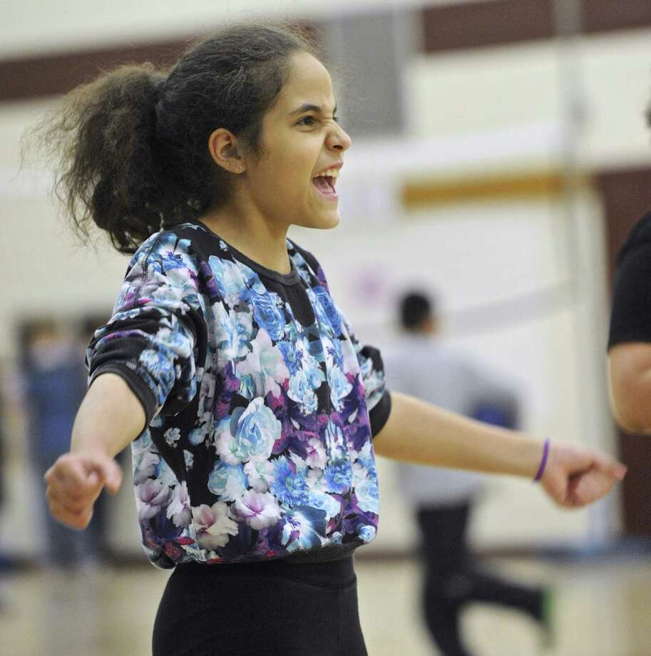 Left, Emily Rodriguez, of Danbury, plays volleyball during the Unified sports program at Broadview Middle School on Wednesday afternoon. Photo: H John Voorhees III / Hearst Connecticut Media / The News-Times