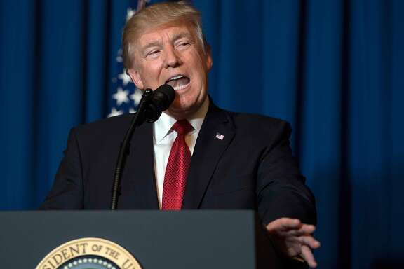 TOPSHOT - US President Donald Trump delivers a statement on Syria from the Mar-a-Lago estate in West Palm Beach, Florida, on April 6, 2017. Trump ordered a massive military strike against a Syria Thursday in retaliation for a chemical weapons attack they blame on President Bashar al-Assad. A US official said 59 precision guided missiles hit Shayrat Airfield in Syria, where Washington believes Tuesday's deadly attack was launched.  / AFP PHOTO / JIM WATSONJIM WATSON/AFP/Getty Images