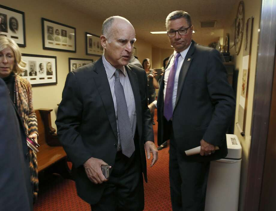 Gov. Jerry Brown walks into a meeting of the Senate Democratic Caucus to urge them to approve a transportation plan,Thursday, April 6, 2017, in Sacramento, Calif. Brown and top legislative leaders pressed all week to convince fellow Democrats to support the measure that would place a $5-billion-a-year boost in California's gas and vehicle taxes to pay for major road repairs. (AP Photo/Rich Pedroncelli) Photo: Rich Pedroncelli, Associated Press