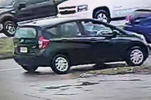 The Baytown Police Department released photos of a suspect vehicle that authorities believe is related to the murder of lawman Clint Greenwood.