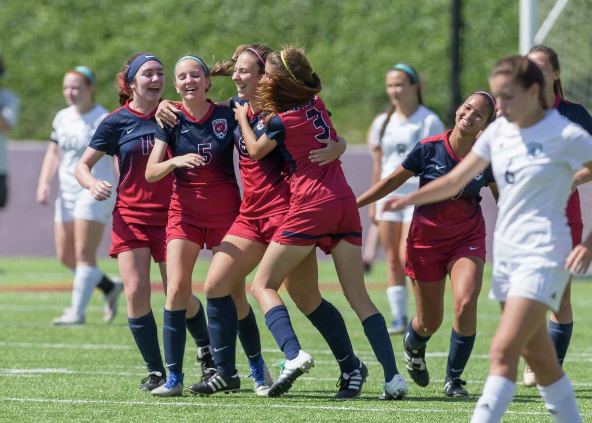 April 7, 2017: Tompkins Falcons team celebrate after scoring three goals in the first half of the Region III Session I girls soccer match, Tompkins vs Kingwood on April 7, 2017 at Abshier Stadium in Deer Park, Texas. (Leslie Plaza Johnson/Freelance)