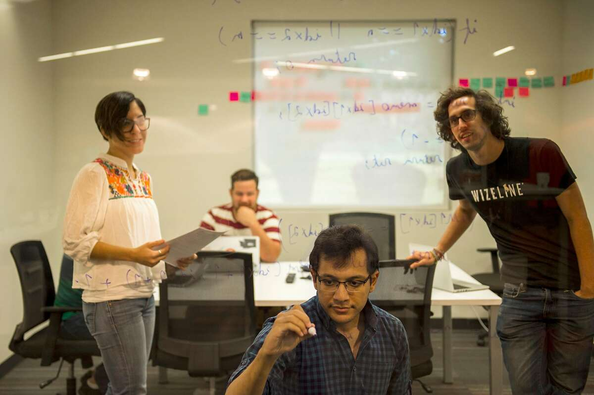 """(L-R) Cindy Blanco, Jorge Fernandez , Ziad Mohamed, Alejandro Abarca employees of Wizeline work at the Wizeline Inc. office in Guadalajara, Mexico, on Friday, April 07, 2017. Wizeline, a San Francisco startup that does """"intelligent software,"""" has opened up a Guadalajara office, in Mexico's tech hub. A reason behind them opening it is because the visa rules there are easier, compared to the U.S"""