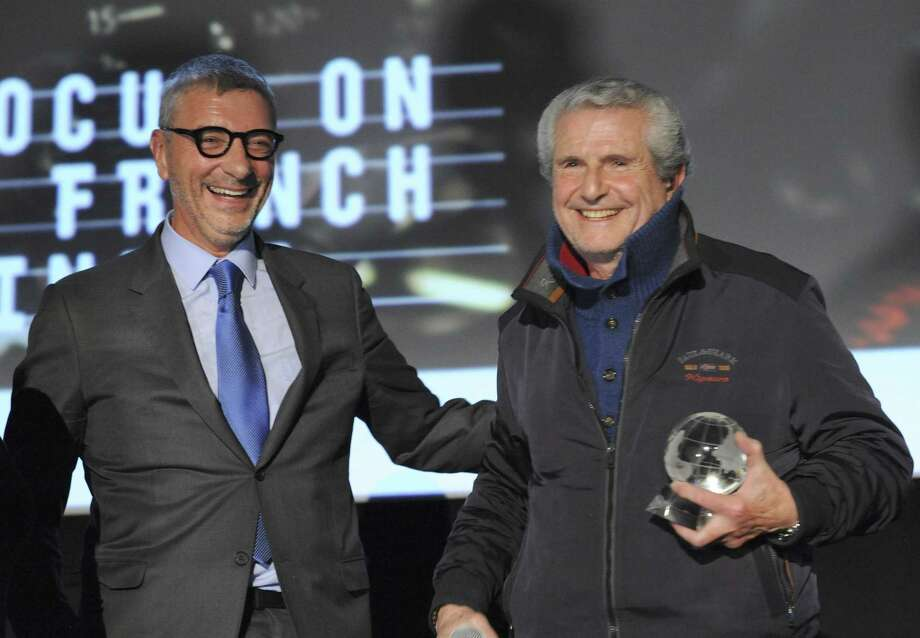 Jean Yves Fillion of BNP Paribas giving director Claude Lelouch the FOCUS award at Alliance Francais Greenwich Focus on French Cinema's 13th annual festival last weekend at the Bow Tie Cinemas in Greenwich. Photo: Contributed /