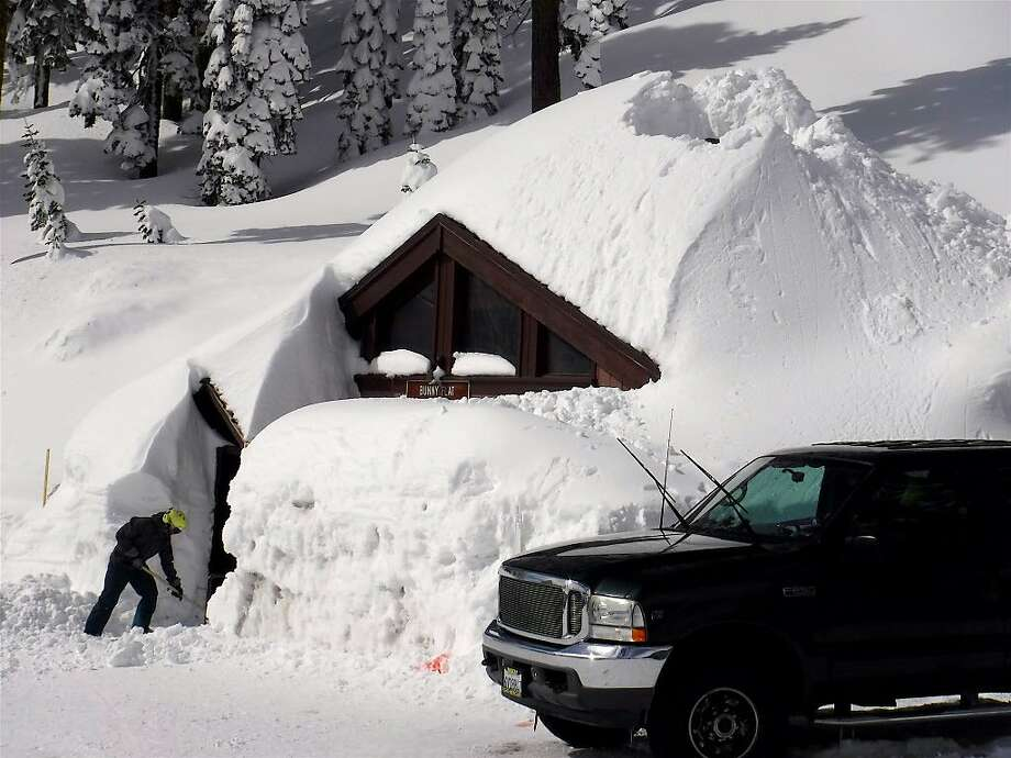 So much snow has fallen on Mount Shasta, here at en elevation of 6,950 at the Bunny Flat Trailhead, that crews had to dig out the restroom last Friday Photo: Tom Stienstra / Tom Stienstra / The Chronicle