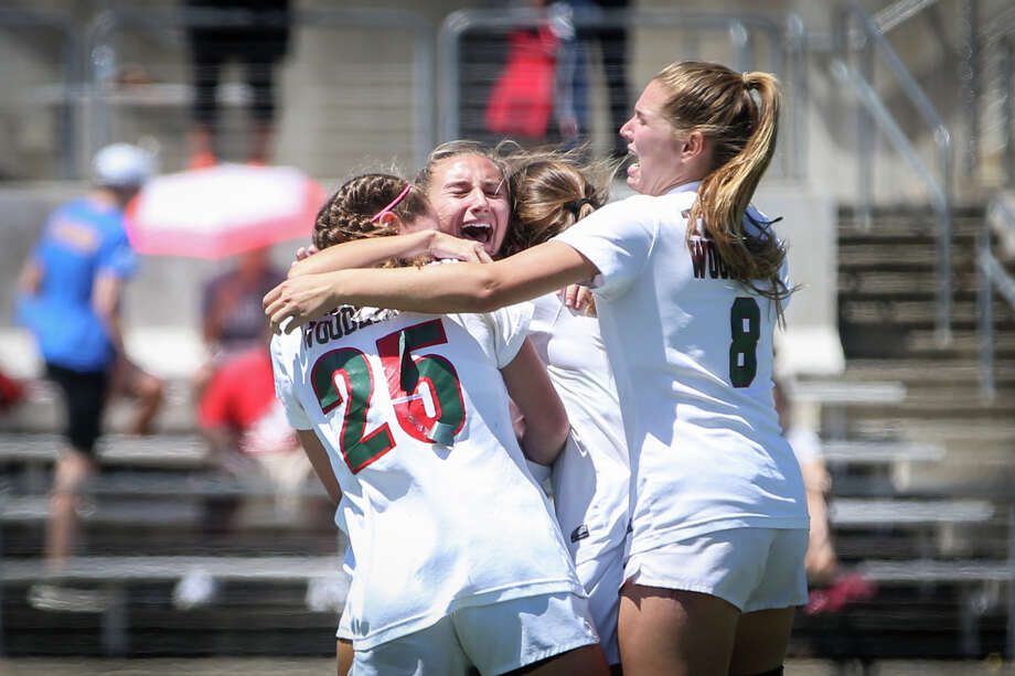 The Woodlands Lady Highlanders celebrate during the varsity girls soccer game against Klein on Friday, April 7, 2017, at Kelly Reeves Stadium in Austin. (Michael Minasi / Houston Chronicle) Photo: Michael Minasi/Houston Chronicle
