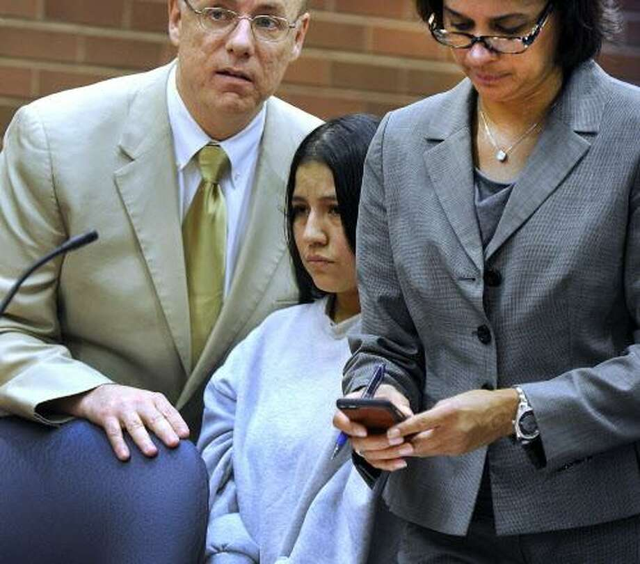 Lidia Quilligana, a a Danbury nanny accused of abusing three children last year, appears in Superior Court Wednesday, May 4, 2016, with her attorney Jennifer Tunnard, and assisted by interpreter, Javier Lillo. Photo: Carol Kaliff / Hearst Connecticut Media / The News-Times