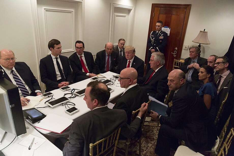 In this image provided by the White House, President Donald Trump receives a briefing on the Syria military strike from his National Security team after the strike at Mar-a-Lago in Palm Beach, Fla., Thursday night, April 6, 2017.  Photo: Associated Press