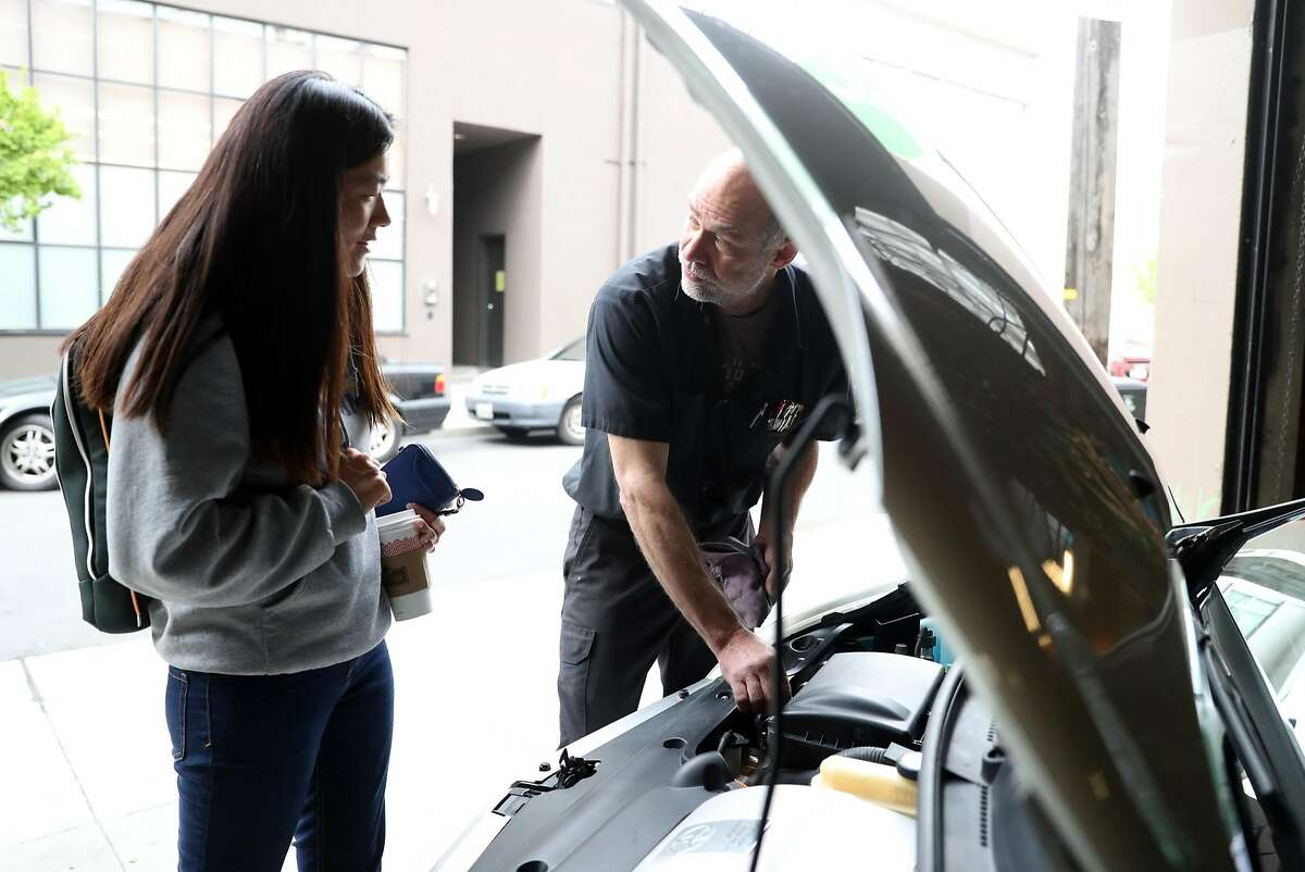 Luscious Garage's Doug Foredell talks to customer Annatai Owens about maintaining her vehicle properly. Garage owner Carolyn Coquillette has created a software program for other indie garages to manage their customer's maintenance schedules. Photographed in San Francisco, Calif., on Friday, April 7, 2017.