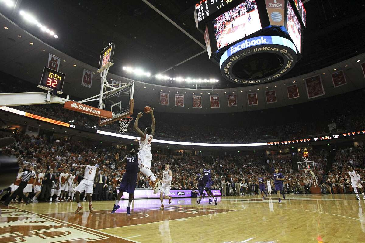 Cameron Ridley gets a big slam dunk under the Jumbotron as the Texas Longhorns host Kansas State at the Erwin Center in Austin on March 7, 2015.