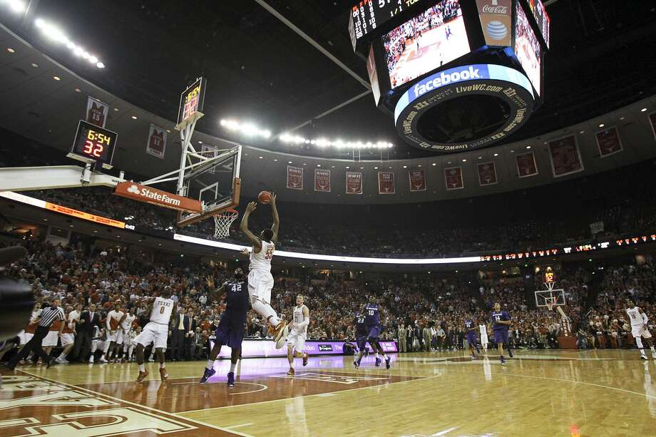 Cameron Ridley gets a big slam dunk under the Jumbotron as the Texas Longhorns host Kansas State at the Erwin Center in Austin on March 7, 2015. Photo: Tom Reel /San Antonio Express-News