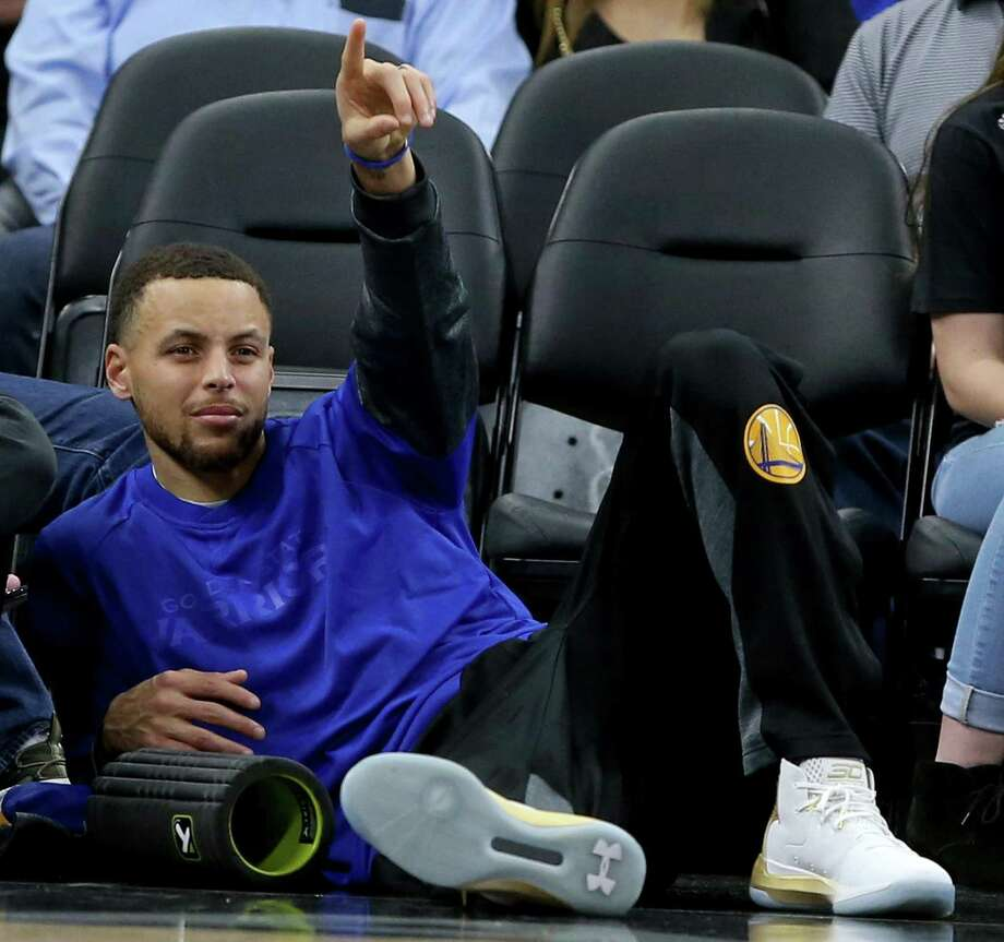 Golden State Warriors' Stephen Curry reacts after a play while watching first half action against the San Antonio Spurs Saturday March 11, 2017 at the AT&T Center. Photo: Edward A. Ornelas / San Antonio Express-News / © 2017 San Antonio Express-News