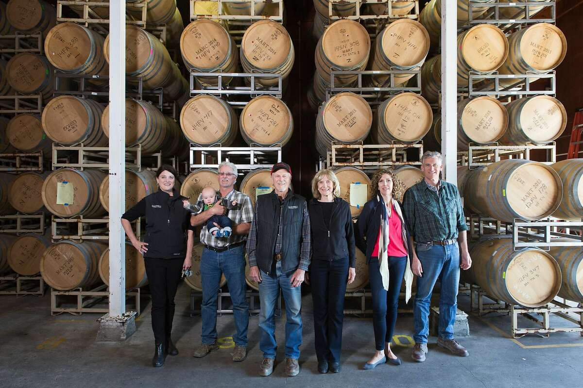 Julie Martinelli, Lee Jr Martinelli, holding Bondi Gorsuch, Lee Sr. Martinelli, Carolyn Martinelli, Regina Martinelli, and George Martinelli posing at the family run winery.