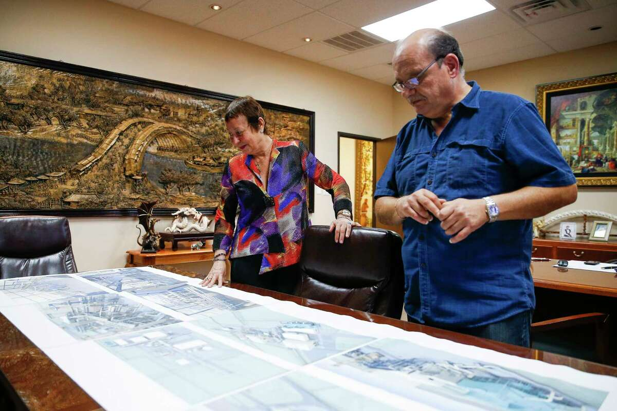 Gorham Group CEO Marlene Sarres and project director Mario Monetta look over plans for a fertilizer plant. Sarres relies on the H1B visa program to get Argentine engineers.